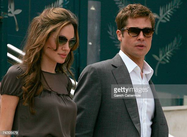 Actors and coproducers Angelina Jolie and Brad Pitt depart the photocall for the film A Mighty Heart at the Palais des Festivals during the 60th...