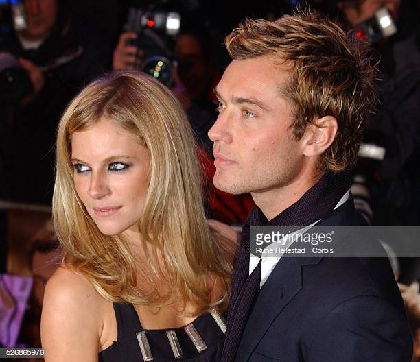 Actors and couple Sienna Miller and Jude Law arrive for the premiere of Charles Shyer's movie Alfie at the Empire Leicester Square in London