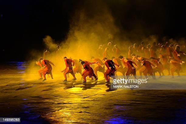 Actors and dancers perform during the opening ceremony of the London 2012 Olympic Games on July 27, 2012 at the Olympic Stadium in London. AFP PHOTO...