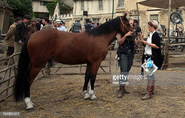 Actors and film crew wait for filming to continue on the set of 'War Horse' which is currently being filmed in Castle Combe on September 22 2010 near...