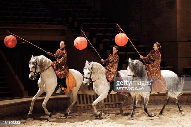 Actors and horses perform on November 22 21011 in Chantilly north of Paris at the Musee vivant du cheval during a rehearsal of French Virginie...
