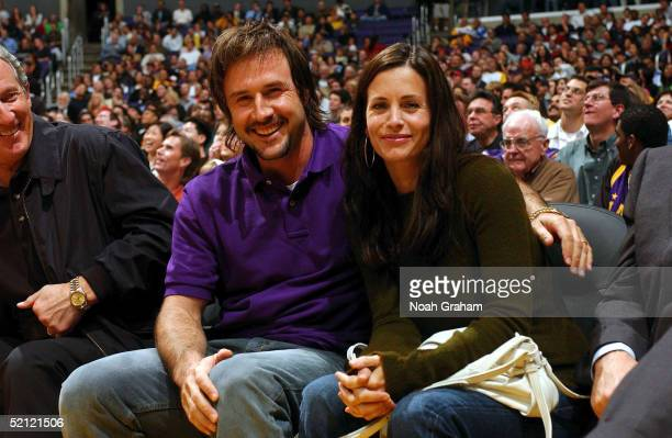 Actors and husband and wife David Arquette and Courteney Cox Arquette sit courtside as the Los Angeles Lakers play against the Portland Trail Blazers...