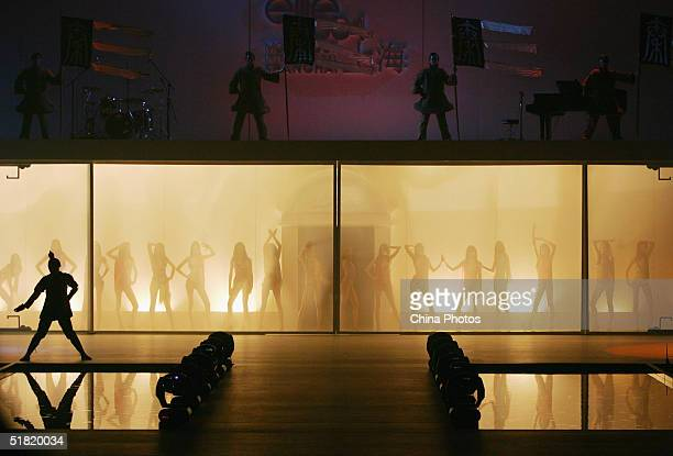Actors and models perform during the OLAY Elite Model Look 2004 International Finals on December 2 2004 in Shanghai China Sofie Oosterwaalal from...