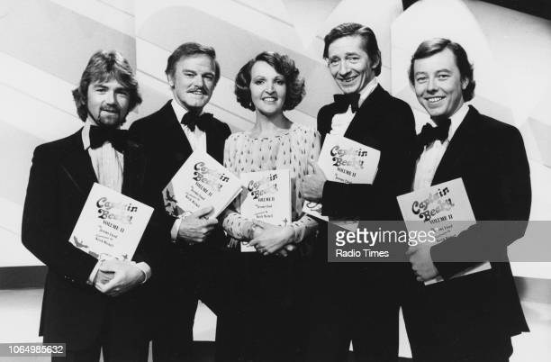 Actors and performers Noel Edmonds, Keith Michell, Penelope Keith, Jeremy Lloyd and Peter Skellern pictured holding programmes for the BBC television...