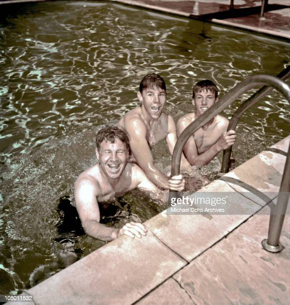 Actors and real life family The Nelsons relax in their pool at home circa 1955 in Los Angeles California