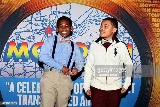 Actors and singers Leon Outlaw Jr and Reed L Shannon who portrays Michael Jackson and Stevie Wonder greets the press during a presentation of the...