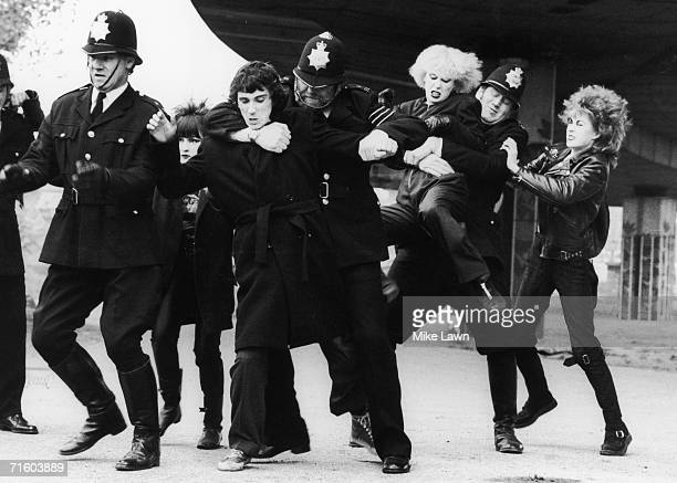 Actors and singers Phil Daniels and Hazel O'Connor take on the British police force in Brian Gibson's film 'Breaking Glass' 30th October 1979