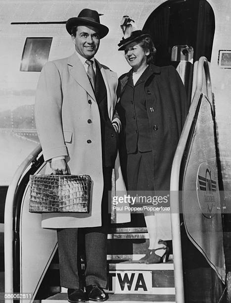 Actors and spouses Charles 'Buddy' Rogers and Mary Pickford leave their airplane as they arrive at La Guardia Airport New York for a vacation on...