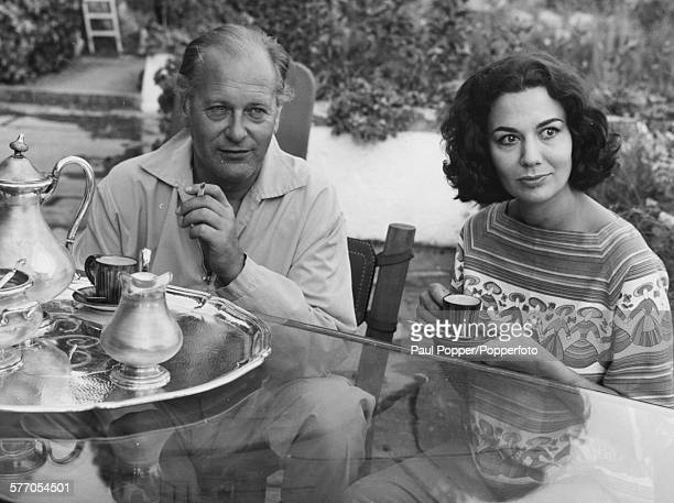 Actors and spouses Curd Jurgens and Simone Bucheron seated together on the terrace of their villa in Saint Jean-Cap-Ferrat in France, July 29th 1959.