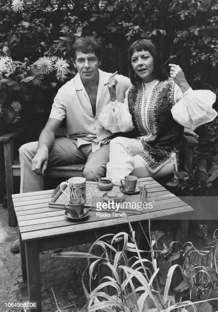 Actors and spouses Derek Waring and Dorothy Tutin sitting outdoors together photographed for Radio Times in connection with her appearance in the BBC...