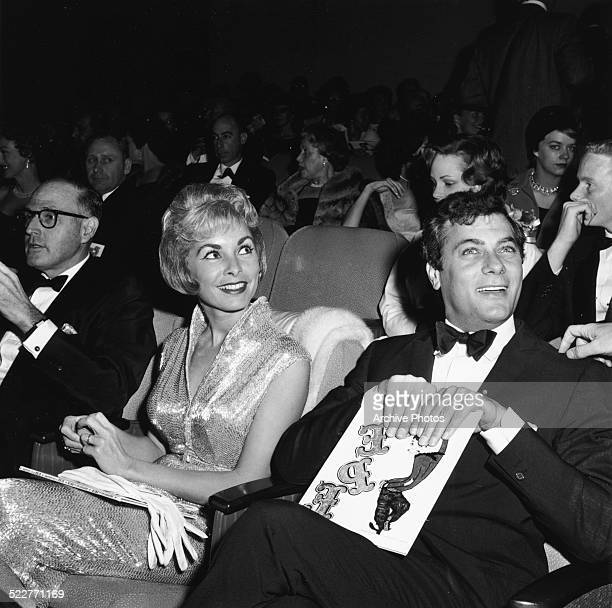 Actors and spouses Janet Leigh and Tony Curtis sitting in the theatre at the premiere of the movie 'Pepe' December 27th 1960