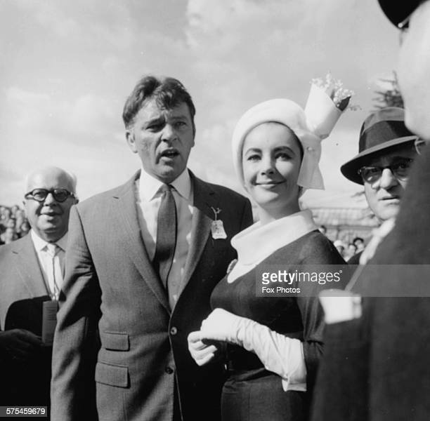 Actors and spouses Richard Burton and Elizabeth Taylor pictured attending the horse races at Sandown Park England August 31st 1963