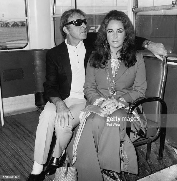 Actors and spouses Richard Burton and Elizabeth Taylor waiting for their flight at Heathrow Airport London September 10th 1970