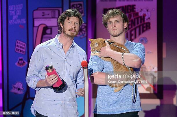 Actors Anders Holm and Logan Paul speak onstage during The 2015 MTV Movie Awards at Nokia Theatre LA Live on April 12 2015 in Los Angeles California
