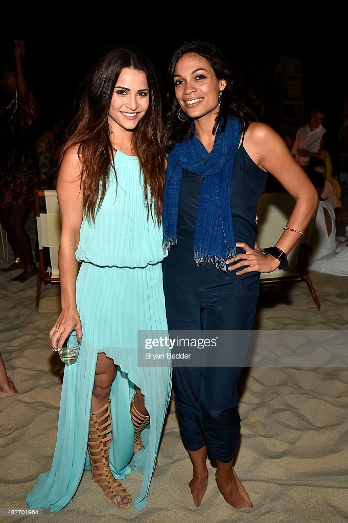 Actors Andi Dorfman and Rosario Dawson attends the Women's Health's 4th annual party under the stars for RUN10 FEED10 on August 1, 2015 in Bridgehampton, New York.