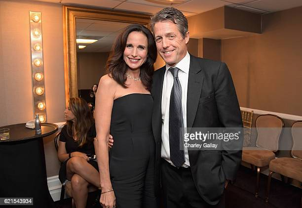 Actors Andie MacDowell and Hugh Grant pose in the green room during the Hollywood Film Awards on November 6 2016 in West Hollywood California
