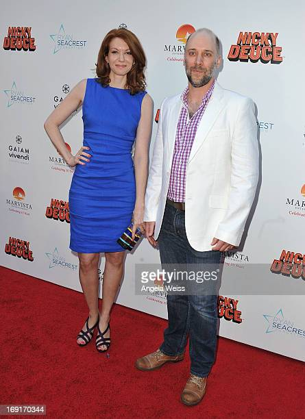 Actors Andrea Frankle and Carlo Mestroni arrive at the premiere of Nickelodeon's 'Nicky Deuce' at ArcLight Cinemas on May 20 2013 in Hollywood...