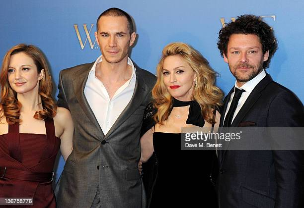 Actors Andrea Riseborough James D'Arcy writer/director Madonna and actor Richard Coyle attend the UK premiere of 'WE' at Kensington Odeon on January...