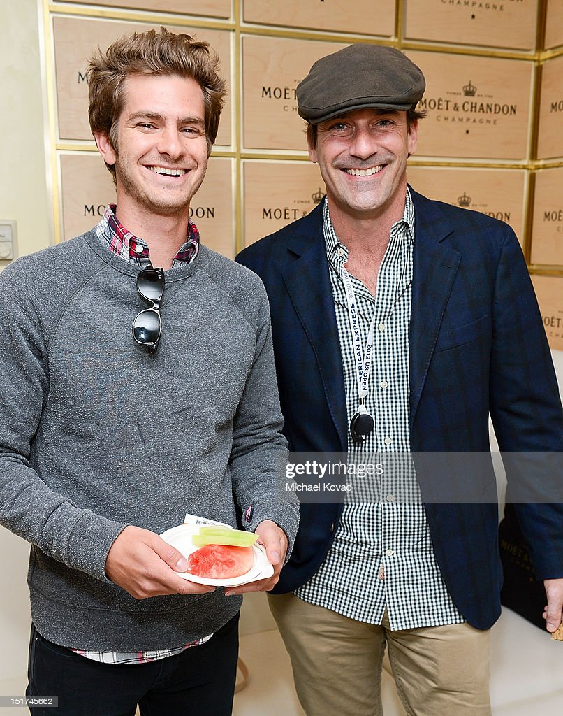 Actors Andrew Garfield (L) and Jon Hamm visit the Moet & Chandon Suite at the 2012 US Open at the USTA Billie Jean King National Tennis Center on September 10, 2012 in the Flushing neighborhood of the Queens borough of New York City.