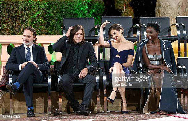 Actors Andrew Lincoln Norman Reedus Lauren Cohan and Danai Gurira speak onstage during AMC presents 'Talking Dead Live' for the premiere of 'The...