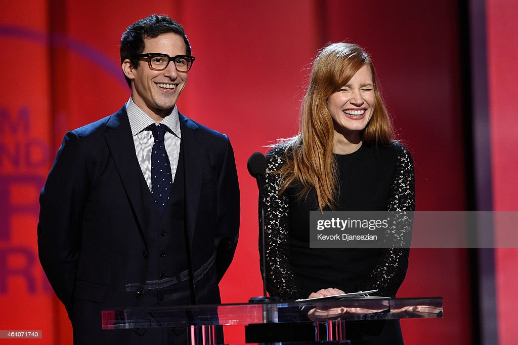 Actors Andy Samberg (L) and Jessica Chastain speak onstage during the 2015 Film Independent Spirit Awards at Santa Monica Beach on February 21, 2015 in Santa Monica, California.