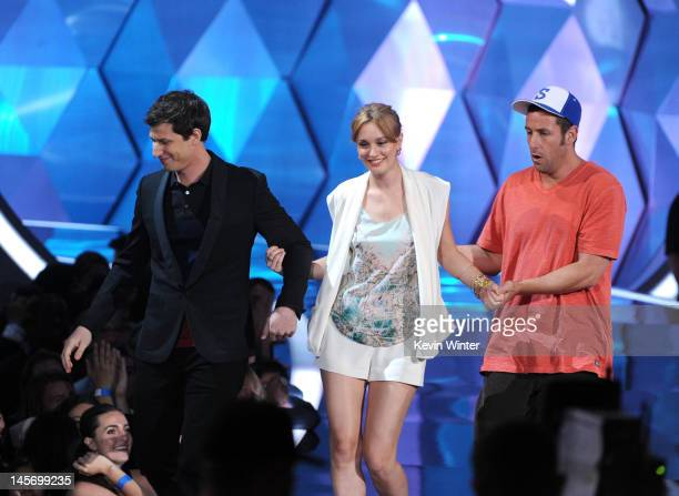 Actors Andy Samberg Leighton Meester and Adam Sandler present an award onstage during the 2012 MTV Movie Awards held at Gibson Amphitheatre on June 3...