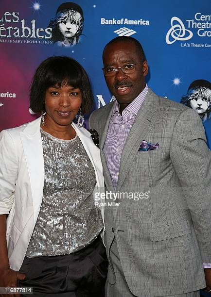 Actors Angela Bassett and Courtney B Vance pose during the arrivals for the opening night performance of Les Miserables at Center Theatre Group's...