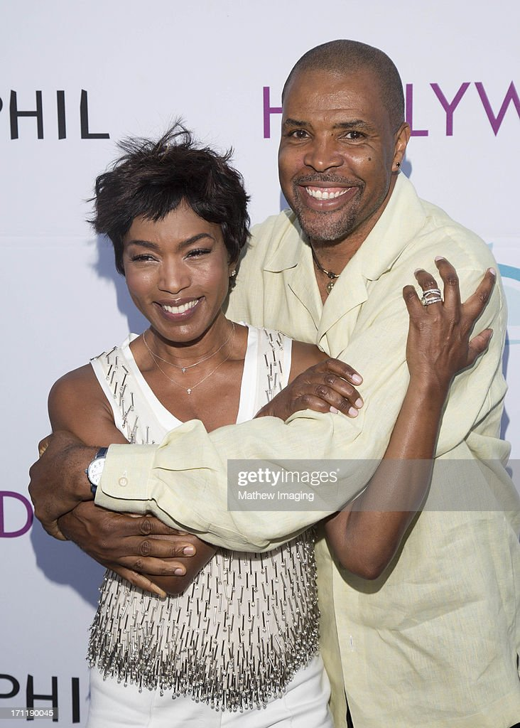 Actors Angela Bassett and Eriq La Salle attend Hollywood Bowl Opening Night Gala - Arrivals at The Hollywood Bowl on June 22, 2013 in Los Angeles, California.