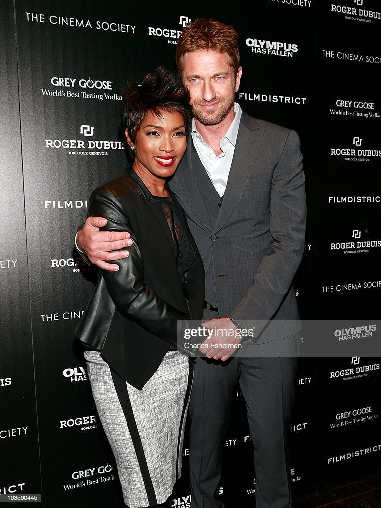 Actors Angela Bassett and Gerard Butler attend The Cinema Society with Roger Dubuis and Grey Goose screening of FilmDistrict's 'Olympus Has Fallen' at the Tribeca Grand Screening Room on March 11, 2013 in New York City.