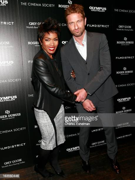 Actors Angela Bassett and Gerard Butler attend The Cinema Society with Roger Dubuis and Grey Goose screening of FilmDistrict's Olympus Has Fallen at...