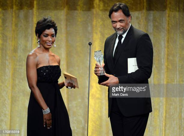 Actors Angela Bassett and Jimmy Smits speak onstage during Broadcast Television Journalists Association's third annual Critics' Choice Television...