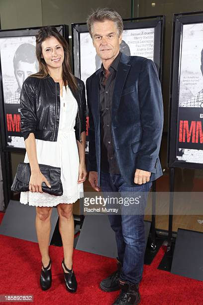 Actors Angela Gots and Harry Hamlin attend the 'Immigrant' Film Premiere at Laemmle's Music Hall 3 on October 25 2013 in Beverly Hills California