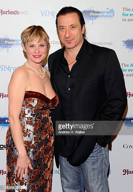 Actors Angelica Page and Federico Castelluccio attend a ceremony in which Page receives honors from FameWall NYC at Hurley's Saloon on October 6 2011...