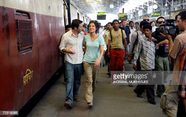 US actors Angelina Jolie alongwith costar Dan Futterman walk inside the Churchgate railway station during a film shoot in Mumbai 13 November 2006...