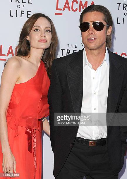 Actors Angelina Jolie and Brad Pitt arrive at the premiere of Fox Searchlight Pictures' 'The Tree of Life' at the Bing Theatre at the Los Angeles...