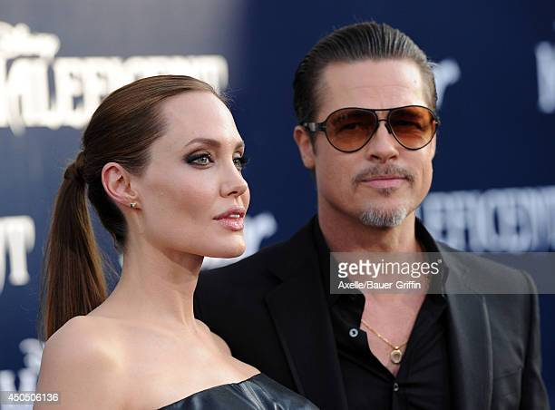 Actors Angelina Jolie and Brad Pitt arrive at the World Premiere of Disney's 'Maleficent' at the El Capitan Theatre on May 28 2014 in Hollywood...