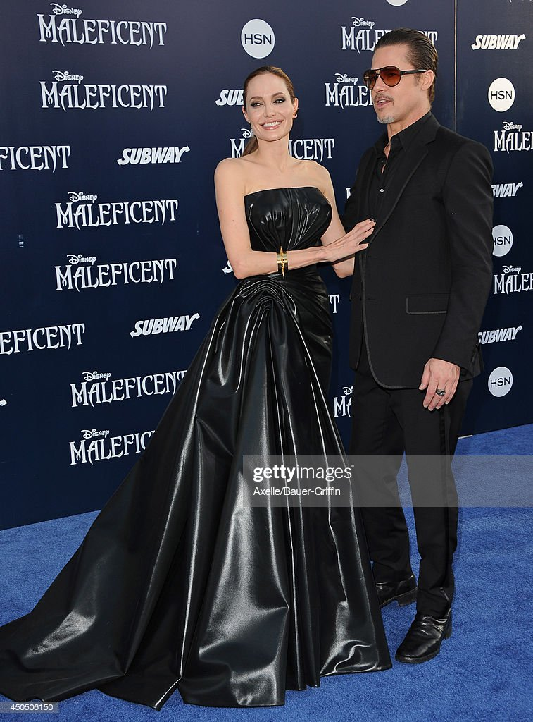 Actors Angelina Jolie and Brad Pitt arrive at the World Premiere of Disney's 'Maleficent' at the El Capitan Theatre on May 28, 2014 in Hollywood, California.