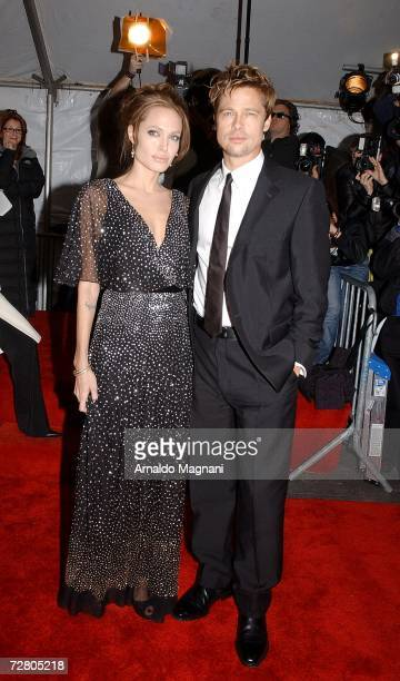 Actors Angelina Jolie and Brad Pitt arrive at the World Premiere of ''The Good Shepherd'' presented by Universal Pictures at the Ziegfeld Theatre on...