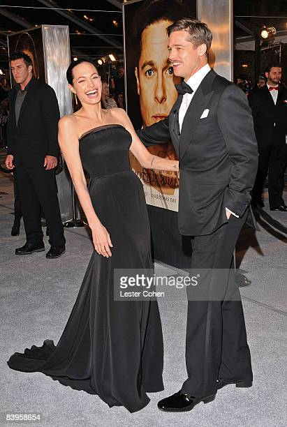 Actors Angelina Jolie and Brad Pitt arrive on the red carpet for the Los Angeles premiere of 'The Curious Case Of Benjamin Button' at the Mann's...