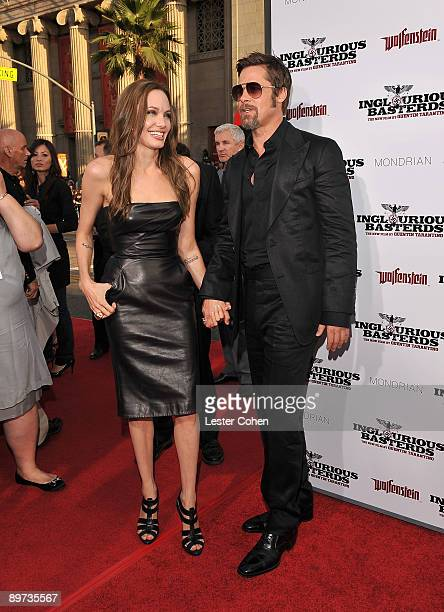 Actors Angelina Jolie and Brad Pitt arrive on the red carpet of the Los Angeles premiere of 'Inglourious Basterds' at the Grauman's Chinese Theatre...