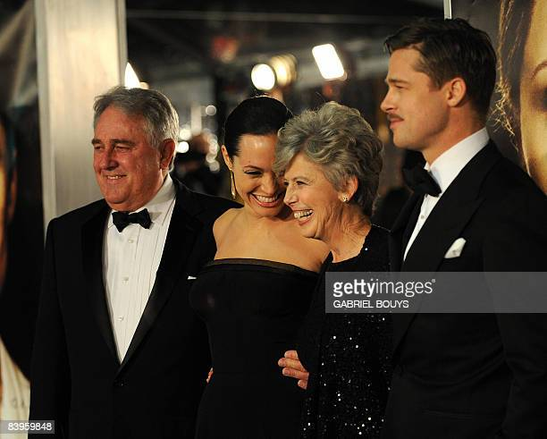 Actors Angelina Jolie and Brad Pitt arrive with Brad Pitt's parents Bill and Jane Pitt for the Los Angeles premiere of 'The Curious Case of Benjamin...