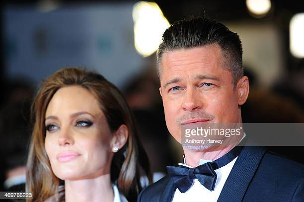 Actors Angelina Jolie and Brad Pitt attend the EE British Academy Film Awards 2014 at The Royal Opera House on February 16 2014 in London England