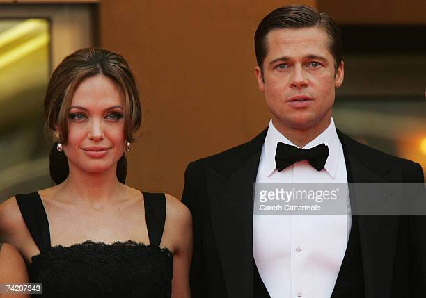 Actors Angelina Jolie and Brad Pitt attend the premiere for the film A Mighty Heart at the Palais des Festivals during the 60th International Cannes...