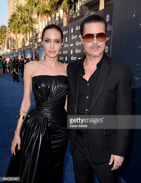 Actors Angelina Jolie and Brad Pitt attend the World Premiere of Disney's 'Maleficent' at the El Capitan Theatre on May 28 2014 in Hollywood...