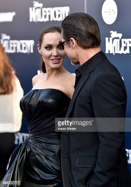 Actors Angelina Jolie and Brad Pitt attend the World Premiere of Disney's Maleficent at the El Capitan Theatre on May 28 2014 in Hollywood California
