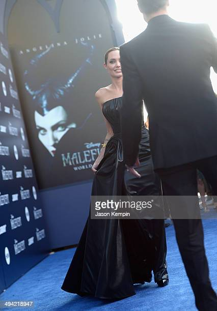 Actors Angelina Jolie and Brad Pitt attend the World Premiere of Disney's 'Maleficent' starring Angelina Jolie at the El Capitan Theatre on May 28...