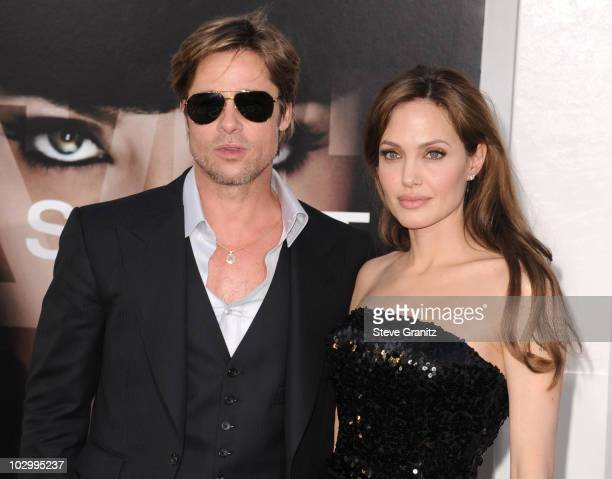 Actors Angelina Jolie and Brad Pitt attends the Salt Los Angeles Premiere at Grauman's Chinese Theatre on July 19 2010 in Hollywood California