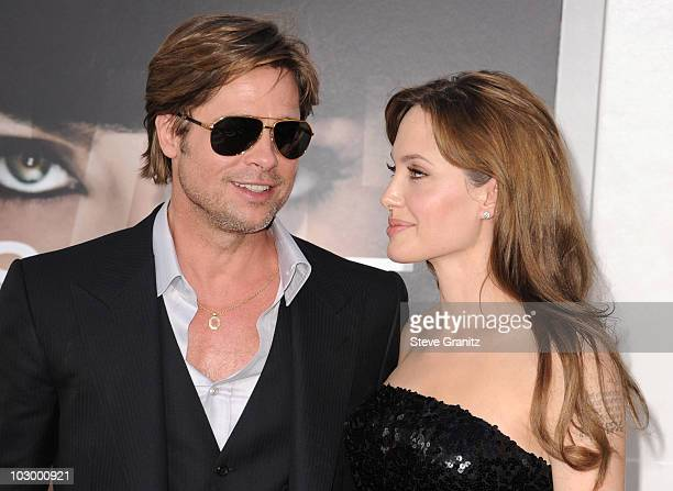 """Actors Angelina Jolie and Brad Pitt attends the """"Salt"""" Los Angeles Premiere at Grauman's Chinese Theatre on July 19, 2010 in Hollywood, California."""
