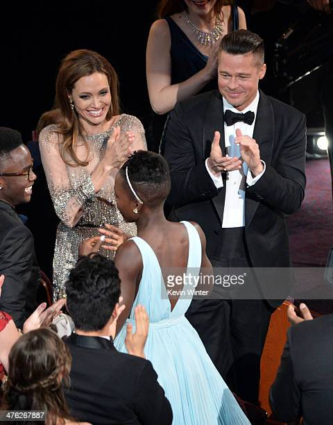Actors Angelina Jolie and Brad Pitt congratulate Lupita Nyong'o on her Best Performance by an Actress in a Supporting Role award for '12 Years a...