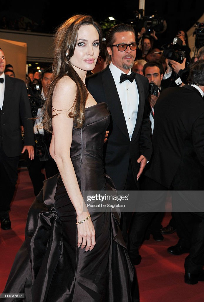 Actors Angelina Jolie (L) and Brad Pitt depart 'The Tree Of Life' premiere during the 64th Annual Cannes Film Festival at Palais des Festivals on May 16, 2011 in Cannes, France.